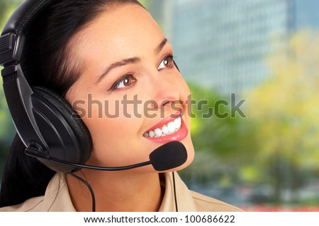 Young business woman with headset. Call center operator.