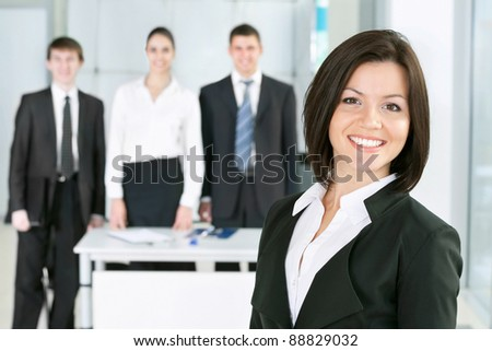 Young business woman with her colleagues