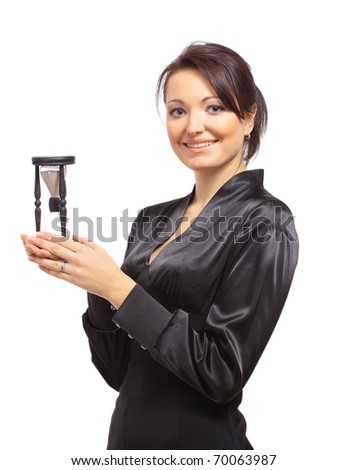 Young business woman with hourglass - time concept - stock photo
