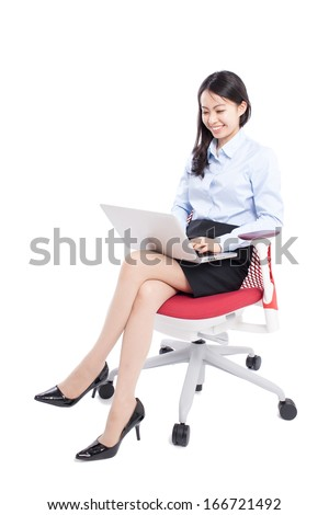young business woman with laptop computer sitting on the chair, isolated on white background