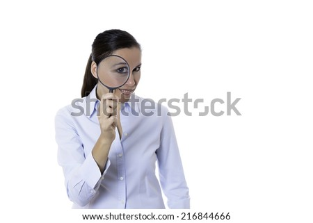young business woman with magnifying glass in the eye standing isolated on a white background - stock photo