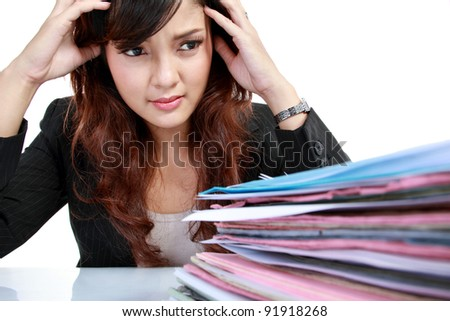 young business woman with many paper stressed at work. Isolated over white background - stock photo
