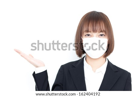 young business woman with mask showing copy space, isolated on white background