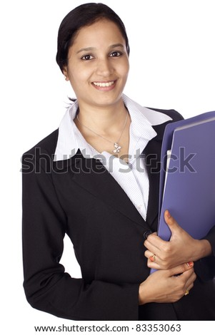 Young business woman with office file against white background - stock photo