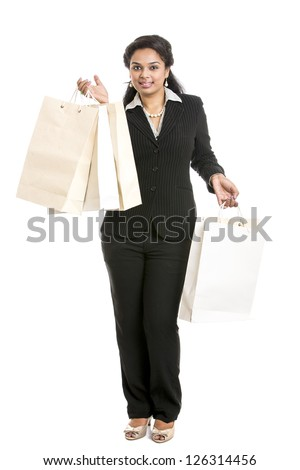Young business  woman with shopping bags over white background