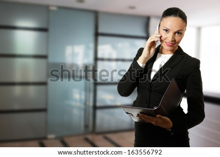 Young business woman,working in front of the office.