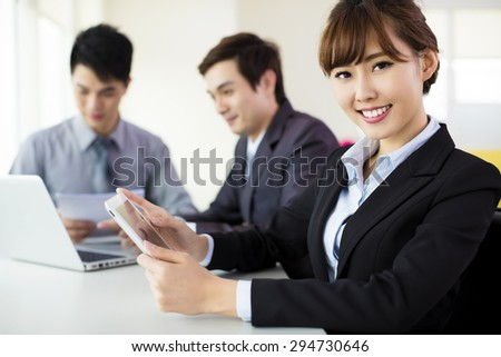 Young business woman working in the office - stock photo