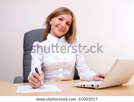 young business woman working on the computer.