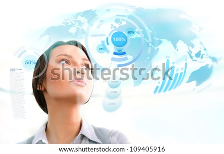 Young business woman working with innovative virtual interface - stock photo