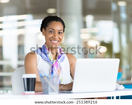 Young business woman working with laptop in office