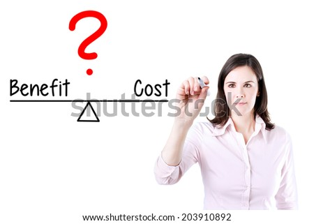 Young business woman writing cost and benefit compare on balance bar. Isolated on white. - stock photo