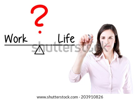 Young business woman writing life and work compare on balance bar. Isolated on white. - stock photo