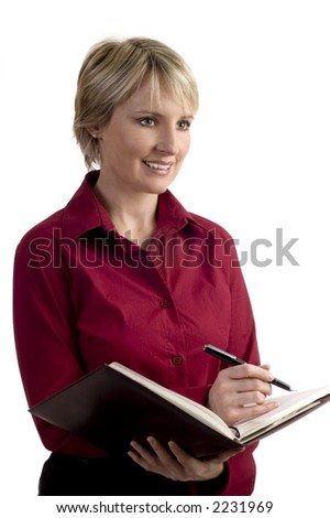 young business woman writing on note book