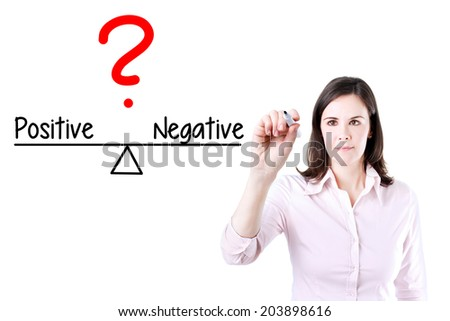 Young business woman writing positive and negative compare on balance bar. Isolated on white. - stock photo