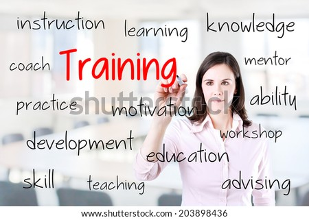 Young business woman writing training concept. Office background. - stock photo