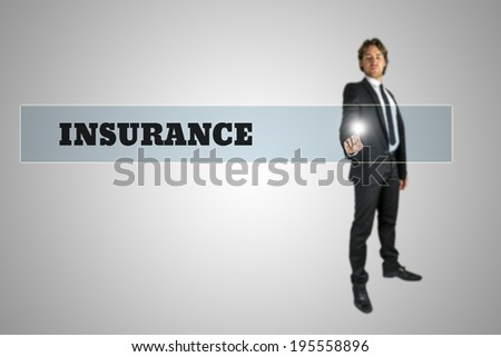 Young businessman activating Insurance button on virtual screen. Concept of online insurance. - stock photo