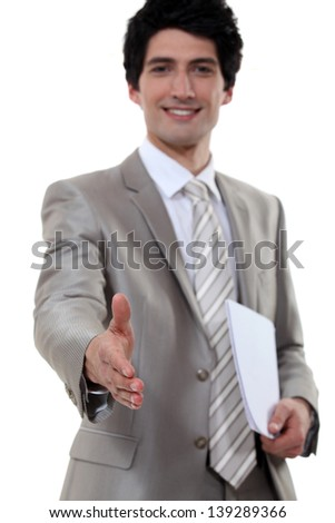 Young businessman all smiles - stock photo