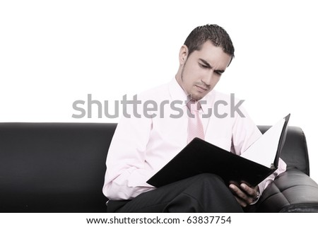 Young businessman analyzing a report in the office