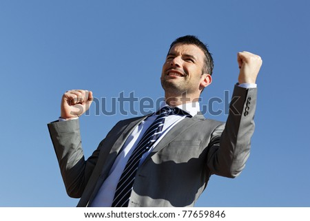 young businessman and blue sky in summer - stock photo