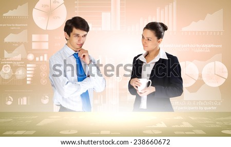 Young businessman and businesswoman discussing financial report - stock photo