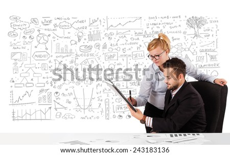 Young businessman and businesswoman planning and calculating with various business ideas - stock photo