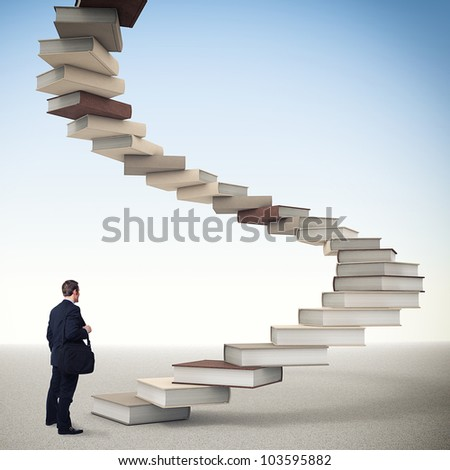 young businessman and 3d book stair - stock photo