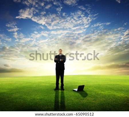 young businessman and sunset - stock photo