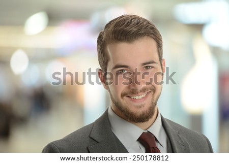 Young Businessman at the airport with background out of focus - stock photo