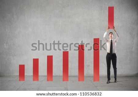 Young businessman being part of a chart - stock photo