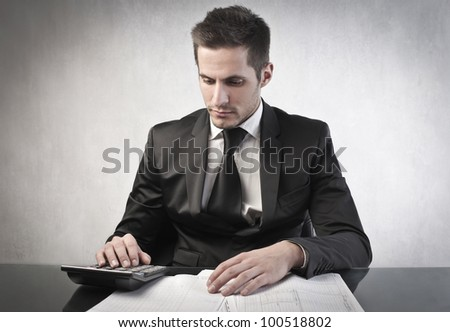 Young businessman budgeting - stock photo
