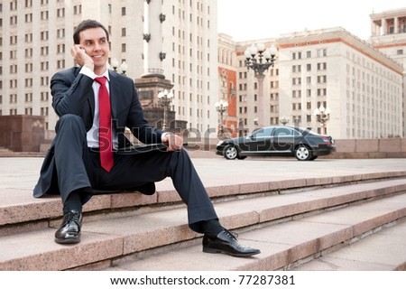 Young businessman calls on mobile in downtown - stock photo