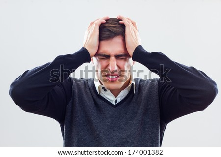 Young businessman can not handle physical pressure at work,Frustrated businessman - stock photo