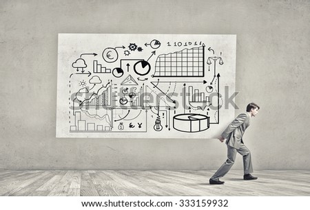 Young businessman carrying banner with his great business plan - stock photo