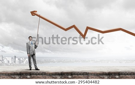 Young businessman caught increasing graph with lead