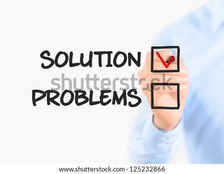 Young businessman check mark on solution concept. Isolated on white. - stock photo