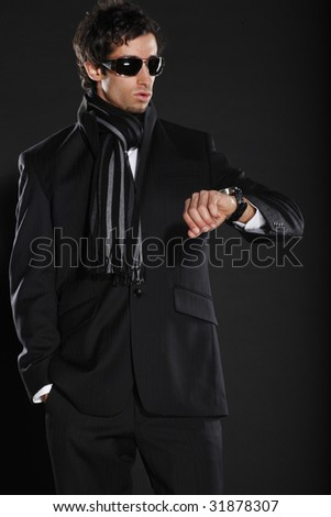 Young Businessman Checking Time - stock photo