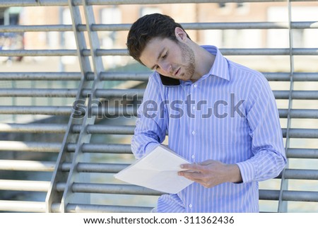 Young businessman discussing business while on the go. - stock photo