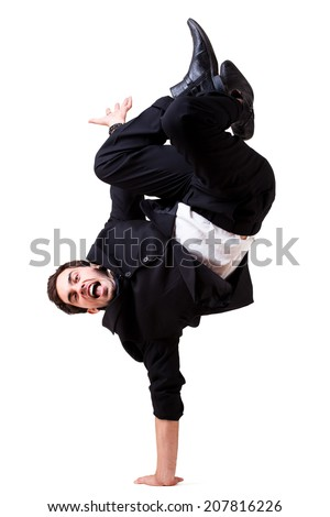 young businessman doing a handstand - stock photo