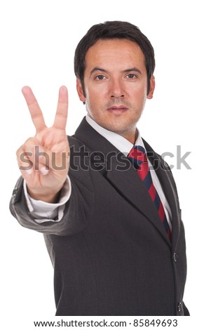 young businessman doing the victory sign
