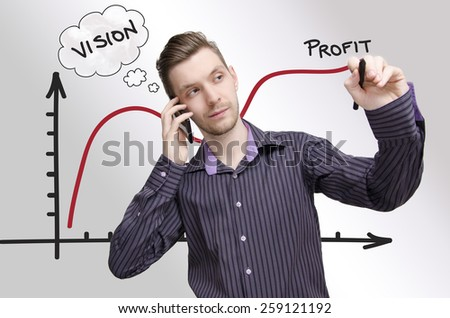 Young businessman drawing profit chart, while talking on phone. Young adult having vision how to make profit - stock photo