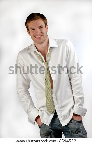 young businessman dressed in  shirt and  tie on  white background