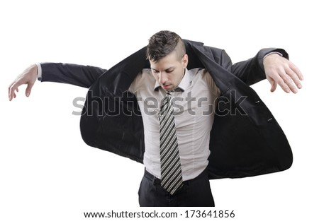 Young businessman dressing his jacket on white - stock photo