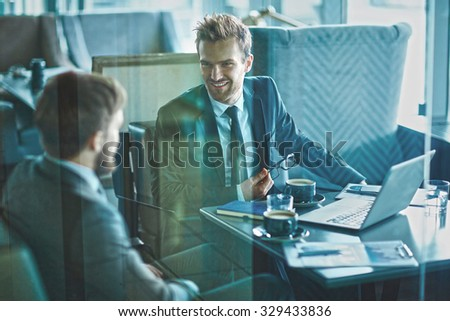 Young businessman explaining his view point to colleague - stock photo