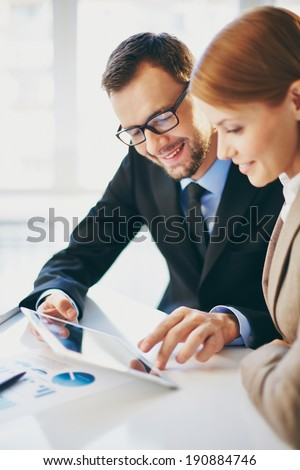 Young businessman explaining ideas to his colleague at meeting - stock photo