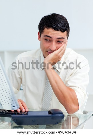 Young businessman getting bored at work - stock photo