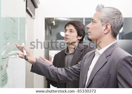 young businessman giving presentation to his colleagues - stock photo