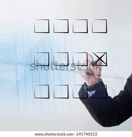 Young businessman hand checking box - stock photo