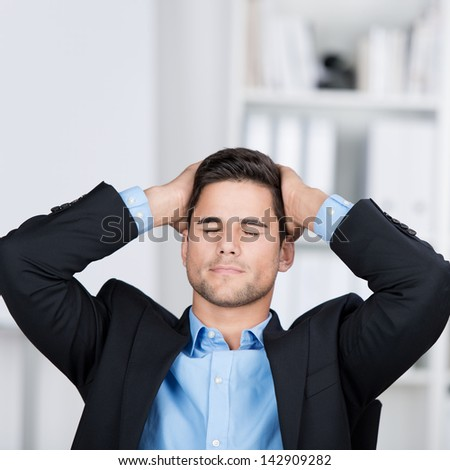 Young businessman having a headache or showing disappointment on some project. - stock photo