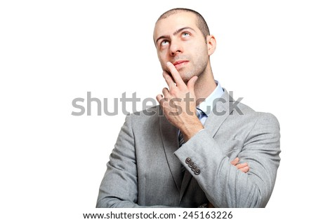 Young businessman having an idea isolated on white - stock photo