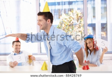 Young businessman having fun at office party, laughing.? - stock photo